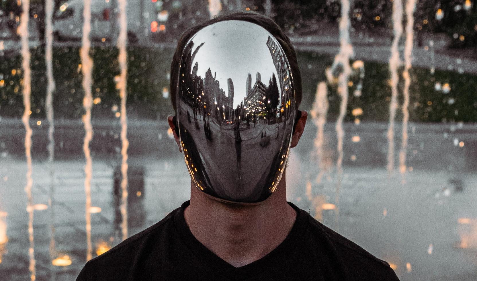 Reflective chrome face mask.